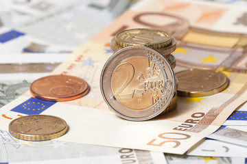 some banknotes on five and fifty euros and coins