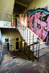 Staircase in abandoned factory.
