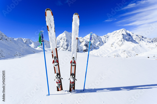 Fototapete Ski, winter season, mountains and ski equipments on ski run