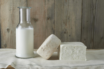 Fresh feta cheese with bottle of milk