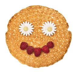 The person, face pancake decorated raspberry and flowers