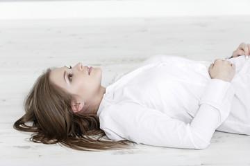 Woman lying on living room floor