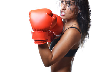 beautiful woman with the red boxing gloves, isolated on white