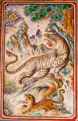Ancient tigers design on wall background in chinese temple at Ph