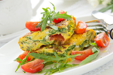 Omelet (Frittata) with tomatoes and herbs.