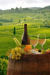 Fototapete - White wine with barell  in vineyard, Chianti, Tuscany, Italy