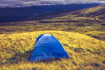 Tent overlooking mountain landscape