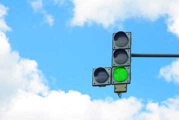 Fotomurales - traffic lights on the background of sky and clouds