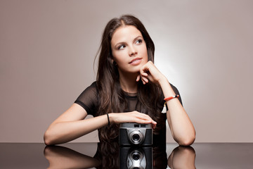 Brunette woman with vintage camera.