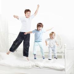 tree boy jump on bed