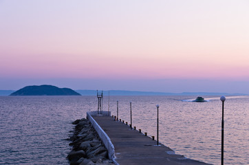 Pier and turtle island in a background, near Neos Marmaros