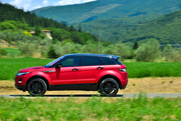 Fototapete - Modern suv on tuscany way