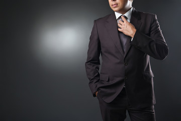 businessman in suit on gray background