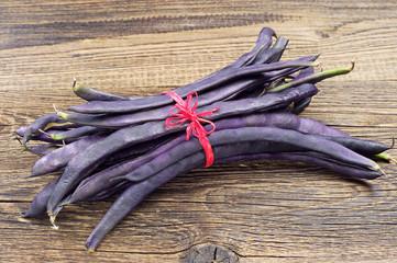 Freshly harvested purple string beans