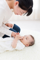asian baby on the white carpet