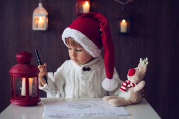 Boy, writing to Santa