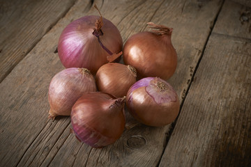 purple onions on wooden table