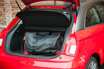 Fototapete - Bag in city car