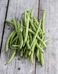 Some Green Beans on wood