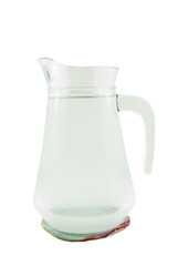 jug of water or glass carafe with coaster on white background