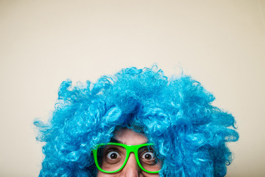 crazy funny bearded man with blue wig