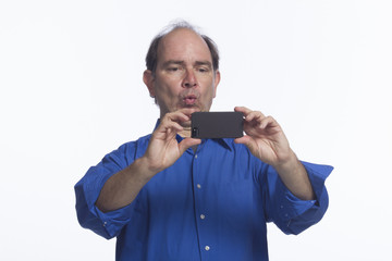 Man taking picture with his smartphone, horizontal