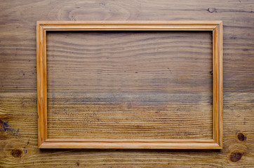 Old wooden frame on wood background
