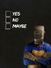 African industrial worker with checklist on blackboard