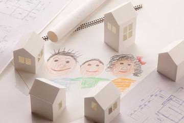 ペーパークラフトの家と家族の絵画