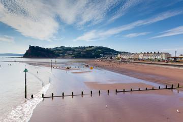 Fototapete - Teignmouth beach Devon England with blue sky