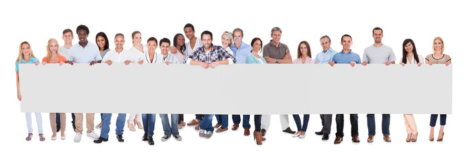 Group of business people with a blank banner