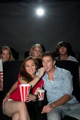 Friends watching movie at cinema