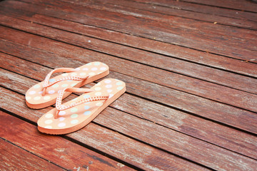 Colorful flip flop sandals on wood background