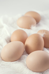 Brown eggs on white cloth
