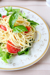 spaghetti with fresh vegetables and herbs