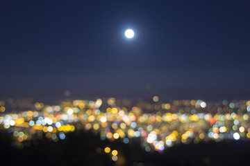 Full Moon Rise Over Blurred City Lights Landscape
