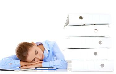 Tired businesswoman asleep at her desk
