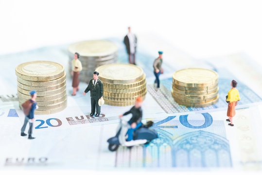 Miniature people on 20 Euro banknotes and coins