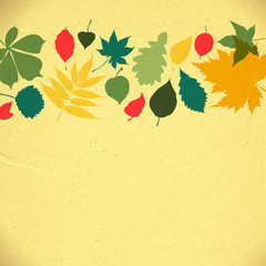 paper autumn leaves background in retro colors.