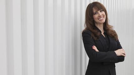 Confident Businesswoman outside office building