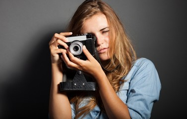 Sexy photographer woman with old camera