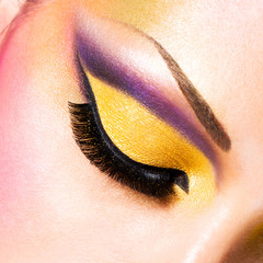 Beautiful face of a woman with fashion makeup