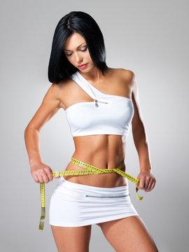 Slim  woman and measure tape