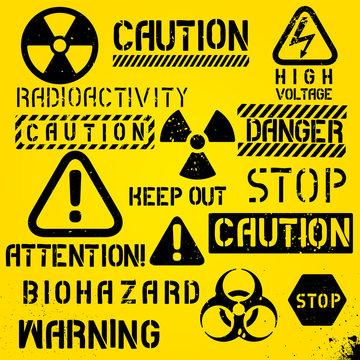 Set of warning hazard symbols and text