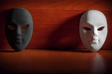 Black and white carnival mask on wooden background with space