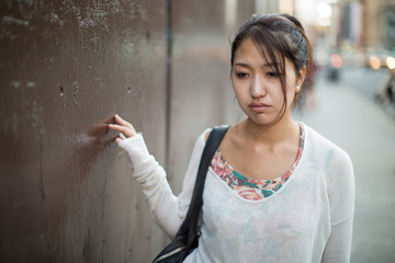 Asian woman walking depressed sad