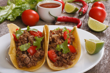 Tacos stuffed with ground beef  and chili sauce on