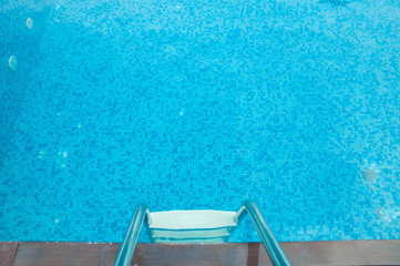 ladder into the pool of blue color without water