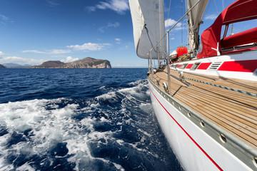 Fototapete - Sail Boat in Sardinia coast, Italy