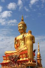 big golden Buddha statue under construction